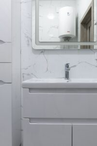 point of use water heater for shower shown in bathroom mirror